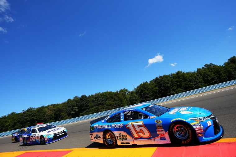 Clint Bowyer, driver of the #15 Maxwell House Toyota, leads David Ragan, driver of the #55 Aaron's Dream Machine Online Version Toyota, during the NASCAR Sprint Cup Series Cheez-It 355 at the Glen at Watkins Glen International on August 9, 2015 in Watkins Glen, New York. (Matt Sullivan/Getty Images)