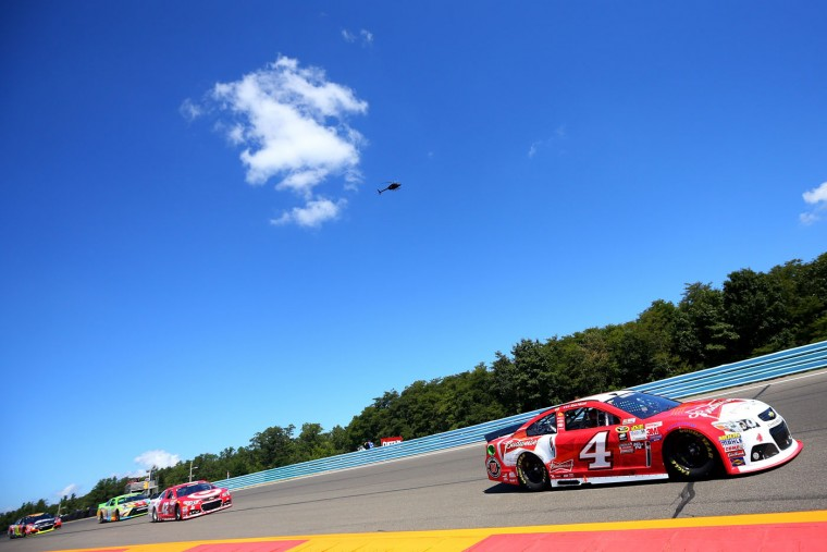 Kevin Harvick, driver of the #4 Budweiser/Jimmy John's Chevrolet, leads a pack of cars during the NASCAR Sprint Cup Series Cheez-It 355 at the Glen at Watkins Glen International on August 9, 2015 in Watkins Glen, New York. (Matt Sullivan/Getty Images)