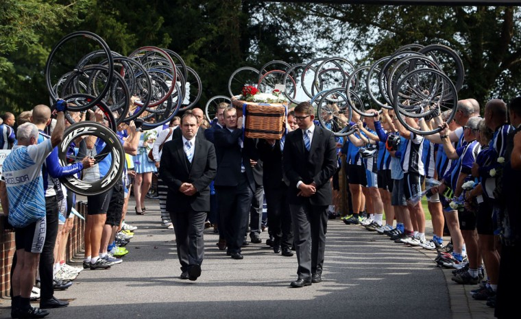 Cyclists perform a guard of honor with their bike wheels as the coffin of great-grandfather Don Lock arrives at Worthing Crematorium on August 12, 2015 in Worthing, West Sussex, England. 79-year-old Lock, a keen cyclist, was stabbed to death in an alleged road rage attack following a collision involving his car and another vehicle on the A24 at Findon, near Worthing, West Sussex, on July 16, 2015. (Photo by Steve Parsons - WPA Pool/Getty Images)