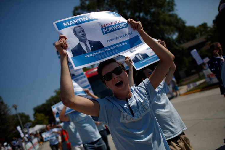 CLEAR LAKE, IA - AUGUST 14: Supporters of Democratic presidential candidate Martin O'Malley rally outside the Iowa Democratic Wing Ding August 14, 2015 in Clear Lake, Iowa. The Wing Ding is held at the historic Surf Ballroom, where Buddy Holly and Ritchie Valens played their final concert, and will feature Democratic presidential candidates Hillary Clinton, Sen. Bernie Sanders (I-VT), Martin O'Malley and Lincoln Chaffee. (Photo by Win McNamee/Getty Images)