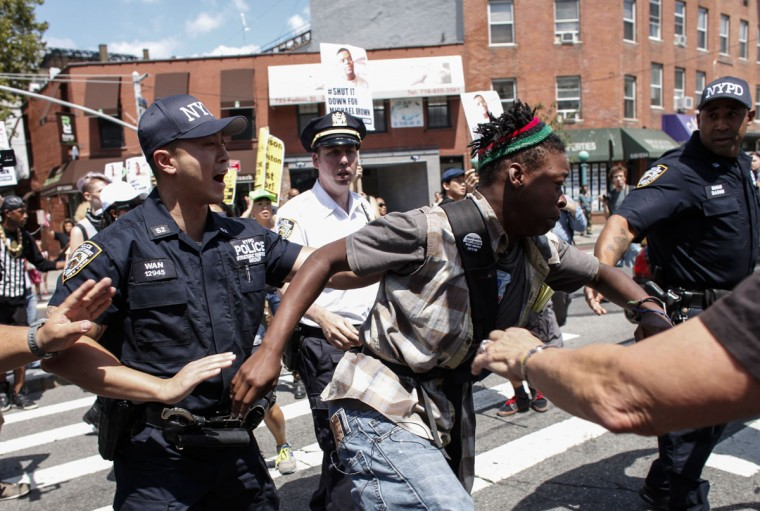 A man (C) is arrested during a Michael Brown memorial protest in Brooklyn, New York on August 9, 2015. Demonstrators showed support Sunday on the one year anniversary of 18-year-old Michael Brown, an unarmed black teen who was shot and killed in Ferguson, Missouri by a white police officer, Darren Wilson, throwing America's troubled race relations into harsh relief. (Kena Betancur/AFP/Getty Images)