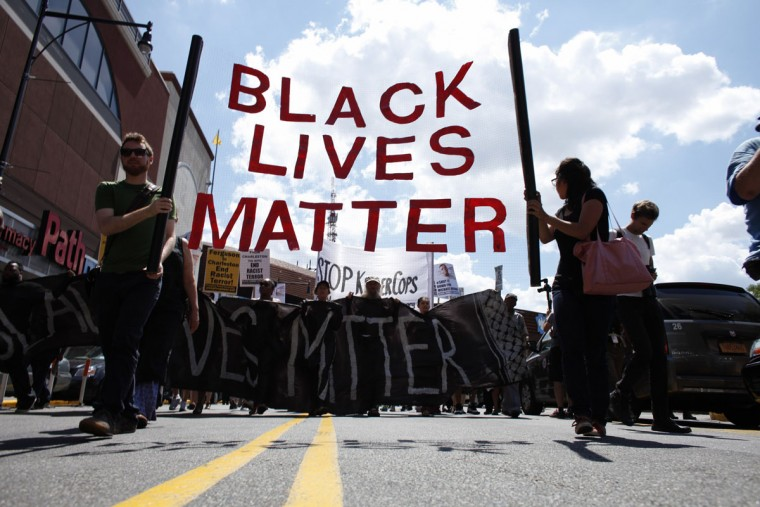 Demonstrators march during a Michael Brown memorial protest in Brooklyn, New York on August 9, 2015. Demonstrators showed support Sunday on the one year anniversary of 18-year-old Michael Brown, an unarmed black teen who was shot and killed in Ferguson, Missouri by a white police officer, Darren Wilson, throwing America's troubled race relations into harsh relief. (Kena Betancur/AFP/Getty Images)