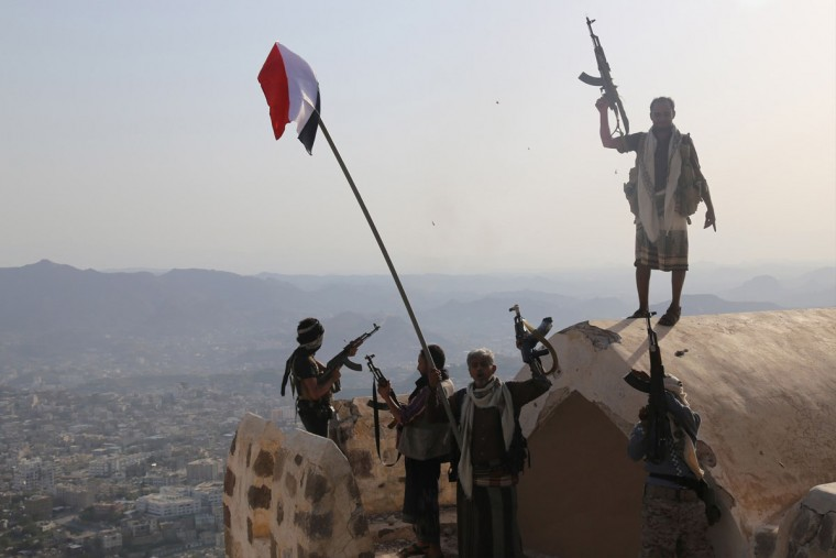 Fighters loyal to Yemen's exiled President Abedrabbo Mansour Hadi stand on top of the Al-Qahira Castle, located on the highest mountain in Yemen's third city Taez, after they seized it from rebel fighters on August 18, 2015. Pro-government and rebel forces have for months fought over Taez, seen as crucial gateway to the rebel-held capital Sanaa. (AFP Photo/Strstr/afp/getty Images )