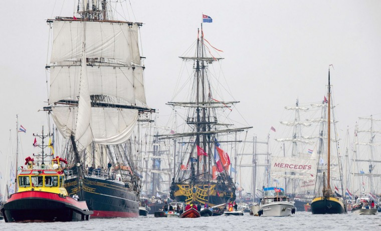 Tall sailing ships sail from Ijmuiden towards Amsterdam, the Netherlands, on August 19, 2015, to join a parade of ships during the five-yearly nautical event Sail 2015. (JERRY LAMPEN/AFP/Getty Images)