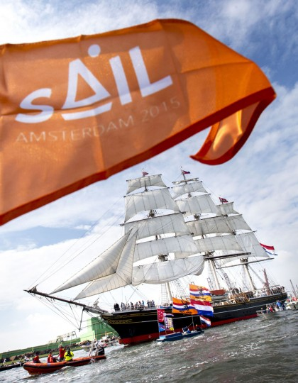 Clipper stad Amsterdam accompanied by smaller boats, enters Amsterdam on August 19 2015, to join the parade of ships during the five-yearly event Sail. (JERRY LAMPEN/AFP/Getty Images)