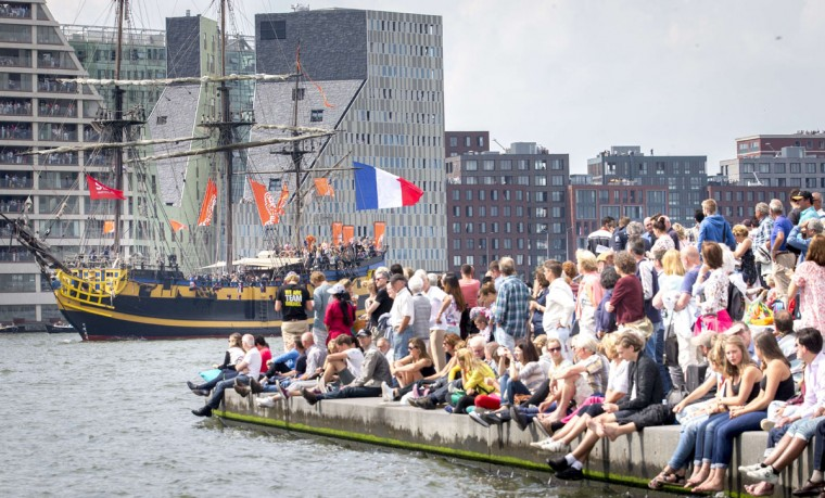 People gather to see the Tall Ships accompanied by smaller boats entering Amsterdam on August 19, 2015, for the five-yearly event Sail. (JERRY LAMPEN/AFP/Getty Images)