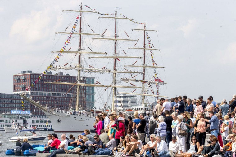 People gather to see the Tall Ships accompanied by smaller boats entering Amsterdam on August 19 2015, for the five-yearly event Sail. (JERRY LAMPEN/AFP/Getty Images)