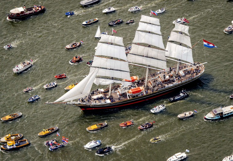 An aerial picture taken on August 19 2015 of the Clipper stad Amsterdam accompanied by smaller boats, on their way to Amsterdam to join the parade of ships during the five-yearly event Sail. (ROBIN VAN LONKHUIJSEN/AFP/Getty Images)