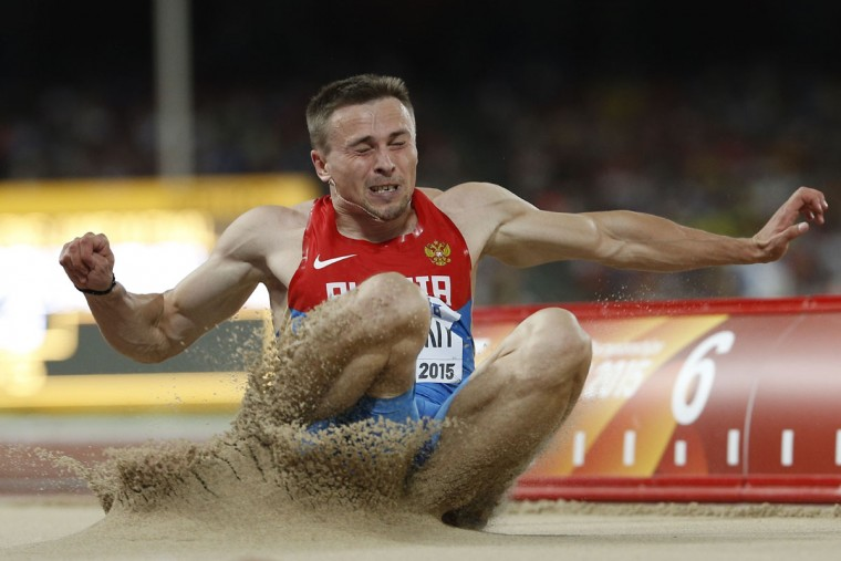 "Russia's Sergey Polyanskiy competes in the final of the men's long jump athletics event at the 2015 IAAF World Championships at the ""Bird's Nest"" National Stadium in Beijing on August 25, 2015. (ADRIAN DENNIS/AFP/Getty Images)"