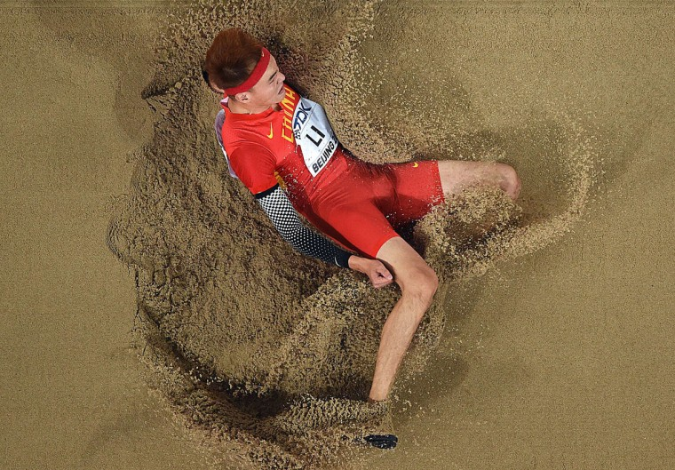 """China's Li Jinzhe competes in the final of the men's long jump athletics event at the 2015 IAAF World Championships at the """"Bird's Nest"""" National Stadium in Beijing on August 25, 2015. (ANTONIN THUILLIER/AFP/Getty Images)"""
