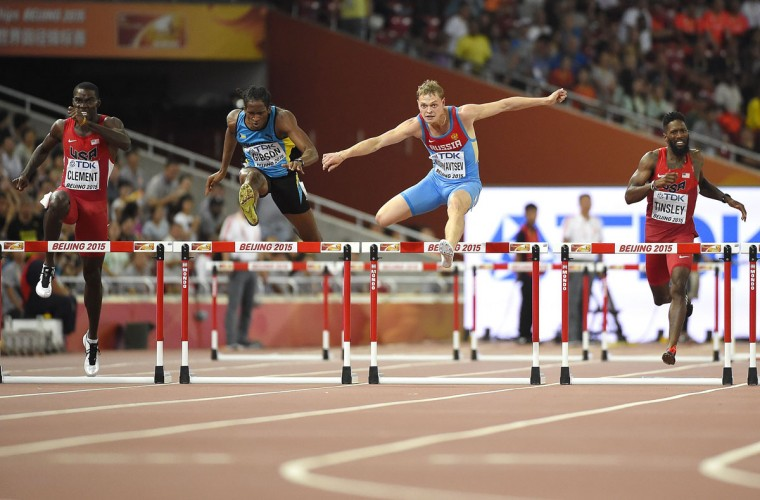 "USA's Kerron Clement, Bahamas' Jeffery Gibson, Russia's Denis Kudryavtsev and USA's Michael Tinsley compete in the final of the men's 400 meters hurdles athletics event at the 2015 IAAF World Championships at the ""Bird's Nest"" National Stadium in Beijing on August 25, 2015. (OLIVIER MORIN/AFP/Getty Images)"