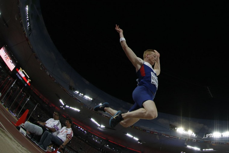 "Britain's Greg Rutherford competes in the final of the men's long jump athletics event at the 2015 IAAF World Championships at the ""Bird's Nest"" National Stadium in Beijing on August 25, 2015. (ADRIAN DENNIS/AFP/Getty Images)"