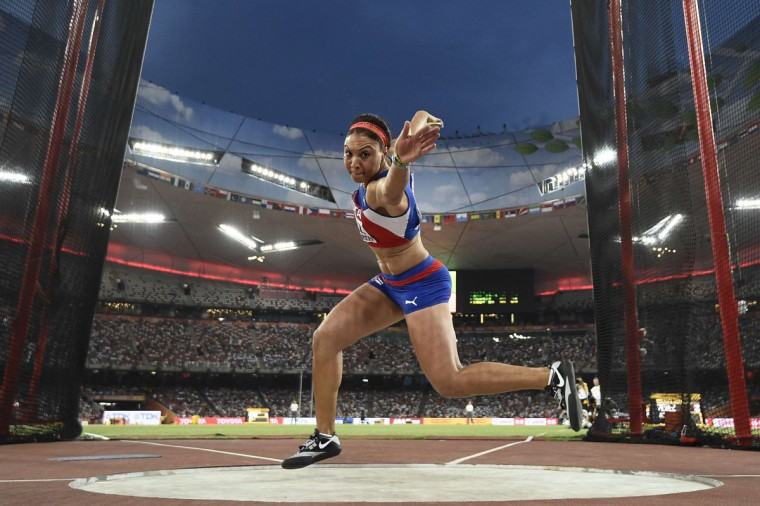 "Cuba's Yaime Perez competes in the final of the women's discus throw athletics event at the 2015 IAAF World Championships at the ""Bird's Nest"" National Stadium in Beijing on August 25, 2015. (FRANCK FIFE/AFP/Getty Images)"