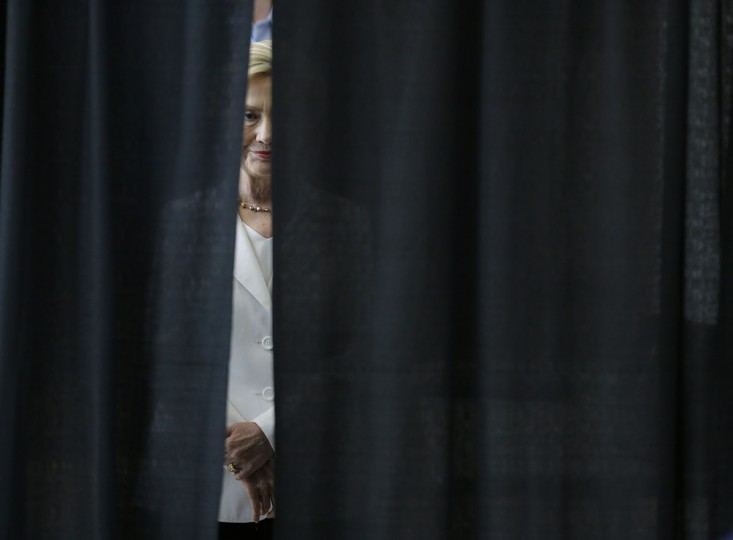 Democratic presidential candidate Hillary Rodham Clinton waits to be introduced before speaking about rural issues at the Des Moines Area Community College, Wednesday, Aug. 26, 2015, in Ankeny, Iowa. (AP Photo/Charlie Neibergall)