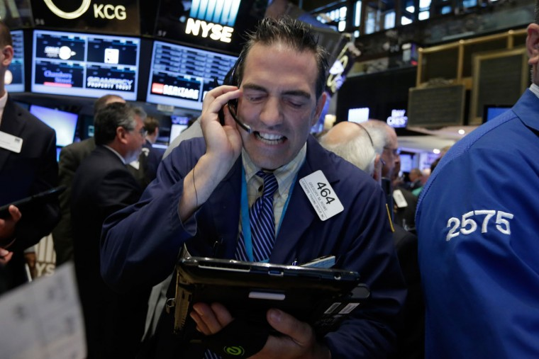 Trader Gregory Rowe works on the floor of the New York Stock Exchange, Tuesday, Aug. 4, 2015. Stocks are mostly higher in early trading as investors focus on the latest earnings and deal news. (AP Photo/Richard Drew)