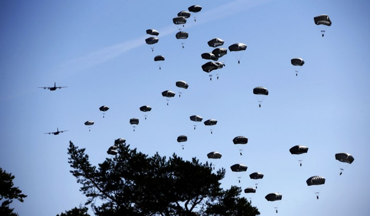 "Paratroopers take part in an exercise of the U.S. Army Global Response Force in Hohenfels, Germany, Wednesday, Aug. 26, 2015. Around 5000 soldiers from 11 NATO nations participated in simultaneous multinational airborne operations across Germany, Bulgaria, Italy and Romania called ""Exercise Swift Response"". The exercise was the largest Allied airborne training in Europe since the end of the Cold War. (AP Photo/Matthias Schrader)"