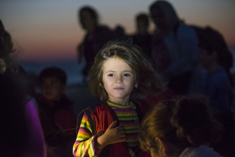 A migrant girl looks towards the see as they arrive on a dinghy at the southeastern island of Kos, Greece, after crossing from Turkey, Thursday, Aug. 13, 2015. Greece has become the main gateway to Europe for tens of thousands of refugees and economic migrants, mainly Syrians fleeing war, as fighting in Libya has made the alternative route from north Africa to Italy increasingly dangerous. (AP Photo/Alexander Zemlianichenko)