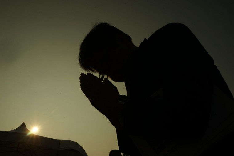 A man prays for the atomic bomb victims in front of the cenotaph at the Hiroshima Peace Memorial Park in Hiroshima, western Japan, early Thursday, Aug. 6, 2015. Japan marked the 70th anniversary of the atomic bombing on Hiroshima. (AP Photo/Koji Ueda)