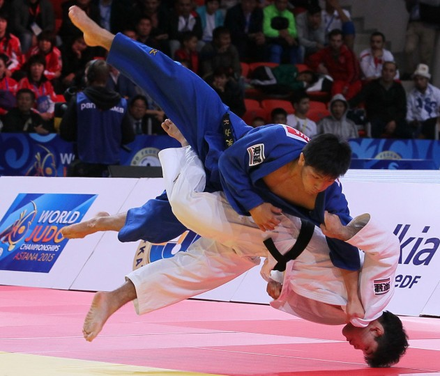 Japan's Shohei Ono, bottom, competes against Japan's Riki Nakaya in the men's 73 kg final at the World Judo Championships in Astana, Kazakhstan, Wednesday, Aug. 26, 2015. Japan's Shohei Ono won the gold medal. (AP Photo/Alexey Filippov)