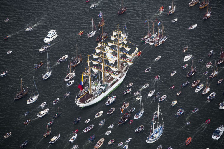Columbian tall ship ARC Gloria is escorted by small boats as it arrives to participate in SAIL Amsterdam 2015, a five-yearly festival celebrating the Dutch capital's maritime history that is expected to draw some 2 million visitors, in Amsterdam, Netherlands, Wednesday, Aug. 19, 2015. The 9th edition of the nautical event runs until Sunday, Aug. 23 on and around the IJ river. (AP Photo/Cris Toala Olivares)