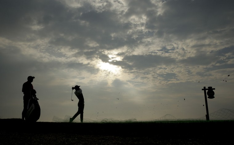 Adam Scott, of Australia, watches his tee shot on the third hole during a practice round for the PGA Championship golf tournament at Whistling Straits Golf Course on Monday, Aug. 10, 2015, in Haven, Wis. (AP Photo/Chris Carlson)