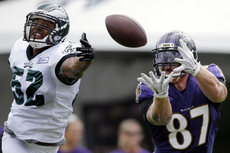 Philadelphia Eagles' Brad Jones (52) defends as Maxx Williams (87) catches a pass during a joint practice at the Eagle's NFL football training camp, Wednesday, Aug. 19, 2015, in Philadelphia. (AP Photo/Matt Rourke)