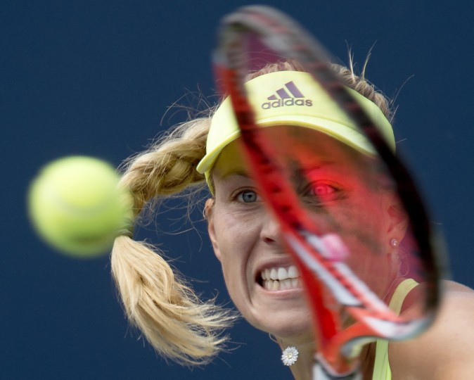 Angelique Kerber, of Germany, hits a return to Simona Halep, of Romania, during the Rogers Cup women's tennis tournament in Toronto, Thursday, Aug. 13, 2015. (Frank Gunn/The Canadian Press via AP)