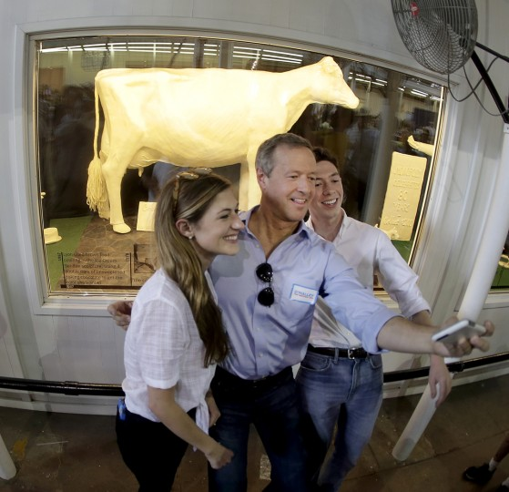 Democratic presidential candidate, former Maryland Gov. Martin O'Malley, takes a photo with his kids Grace and William in front of a cow made of butter at the Iowa State Fair Thursday, Aug. 13, 2015, in Des Moines. (AP Photo/Charlie Riedel)