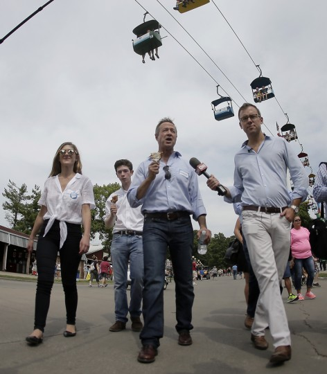 Democratic presidential candidate, former Maryland Gov. Martin O'Malley, is interviewed as he walks the grounds at the Iowa State Fair Thursday, Aug. 13, 2015, in Des Moines. (AP Photo/Charlie Riedel)