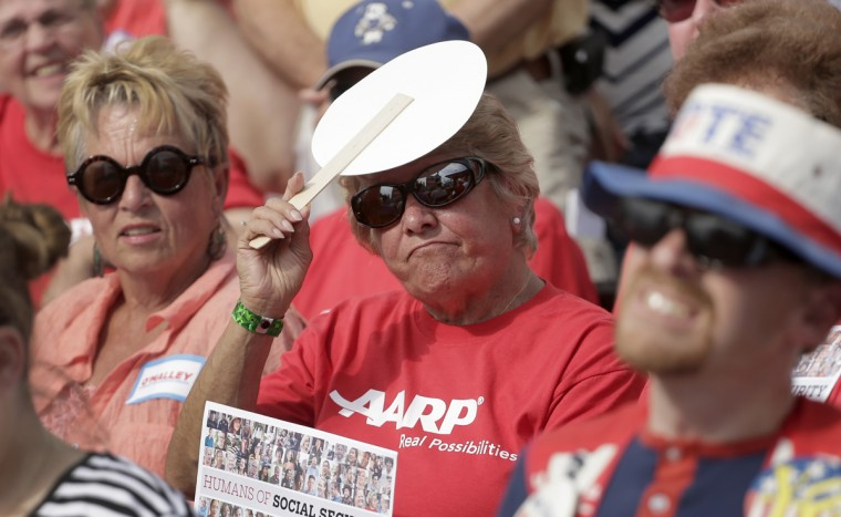 Fairgoers listen to Democratic presidential candidate, former Maryland Gov. Martin O'Malley, as he speaks at the Iowa State Fair Thursday, Aug. 13, 2015, in Des Moines. (AP Photo/Charlie Riedel)