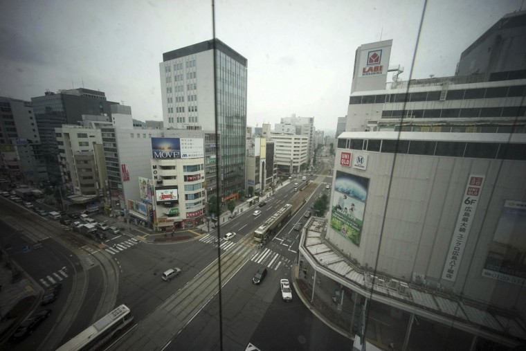 In this July 6, 2015 photo, a crossroad is seen from an elevator of a department store in Hiroshima, western Japan. On Aug. 6, 1945, a U.S. plane dropped an atomic bomb on Hiroshima, the first nuclear weapon has been used in war. Japan surrendered on Aug. 15, ending World War II. (AP Photo/Eugene Hoshiko)