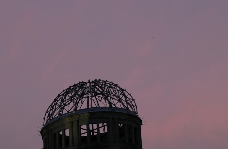 In this July 3, 2015 photo, the Atomic Bomb Dome, as it is known today is seen at dust in Hiroshima, western Japan. In the postwar effort to rebuild Hiroshima, the city decided to conserve the dome as it was in 1961, leaving it as an icon of the devastation in a city where such scars were quickly becoming invisible. The building was registered as a UNESCO World Heritage site in 1996 to call for a non-nuclear world and world peace. (AP Photo/Eugene Hoshiko)