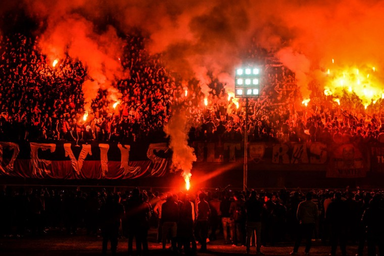 Hardcore soccer fans known as Ultras Ahlawy, light flares and cheer during the third anniversary of people who were killed in the 2012 Port Said soccer riot, at Al -Ahly Sporting Club in Cairo, Egypt. On Feb. 1, 2012 over 70 people were killed in Port Said when Ahly fans were attacked by supporters of Port Said's football team Masry, who stormed the pitch at the end of the match. (AP Photo/Mohammed El Raai)