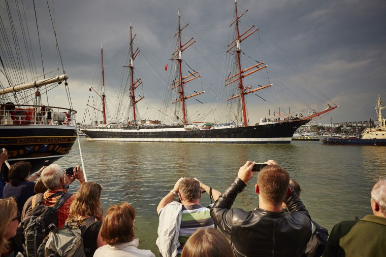 Spectators take pictures as Russian tall ship the Sedov arrives in Amsterdam, Netherlands, Wednesday, Aug. 19, 2015, to participate in SAIL Amsterdam 2015, a five-yearly festival celebrating the Dutch capital's maritime history that is expected to draw some 2 million visitors. The 9th edition of the nautical event lasts until Sunday, Aug. 23 on and around the IJ river. (AP Photo/Phil Nijhuis)