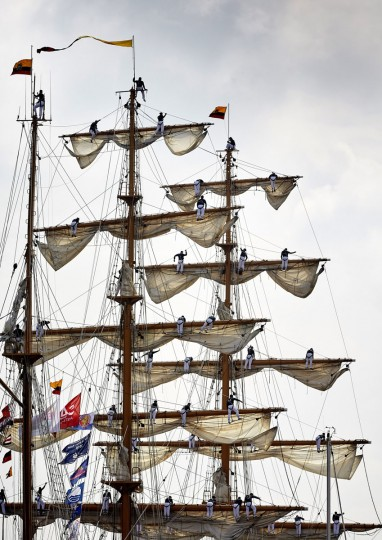 Sailors stand in the rigging of a tall ship as it arrives in Amsterdam, Netherlands, Wednesday, Aug. 19, 2015, to participate in SAIL Amsterdam 2015, a five-yearly festival celebrating the Dutch capital's maritime history that is expected to draw some 2 million visitors. The 9th edition of the nautical event lasts until Sunday, Aug. 23 on and around the IJ river. (AP Photo/Phil Nijhuis)