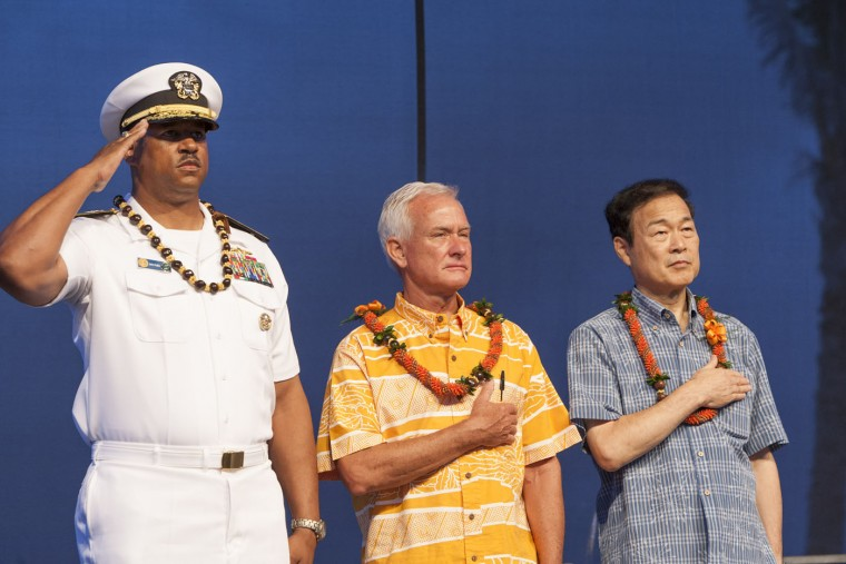 U.S. Navy Read Adm. John Fuller, left, Honolulu mayor Kirk Caldwell, center, and Nagaoka City, Japan mayor Tomio Mori look on during a celebration marking the 70th anniversary of the end of World War II at Joint Base Pearl Harbor-Hickam, Saturday, Aug. 15, 2015, in Honolulu. (AP Photo/Marco Garcia)
