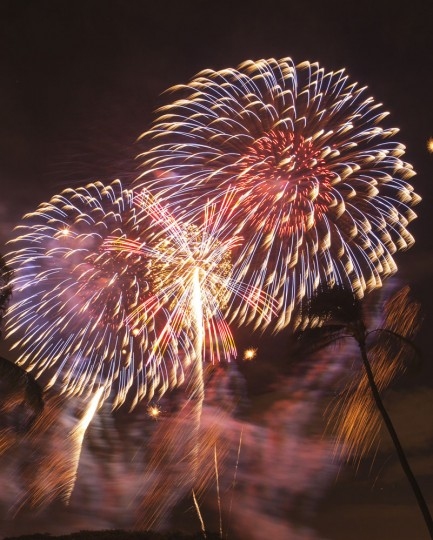 Fireworks from Nagaoka City, Japan explode over Ford Island to celebrate the 70th anniversary of the end of World War II at Joint Base Pearl Harbor-Hickam, Saturday, Aug. 15, 2015 in Honolulu. (AP Photo/Marco Garcia)