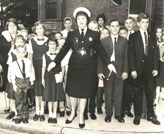 September 5, 1963 - THE EAGER BEAVERS: Mrs. Naomi Fitzhugh, a school crossing guard, holds back students at Twenty-Seventh street and Maryland Avenue who were en route to S. S. Philip and James School. (Walter McCardell/Baltimore Sun archives)
