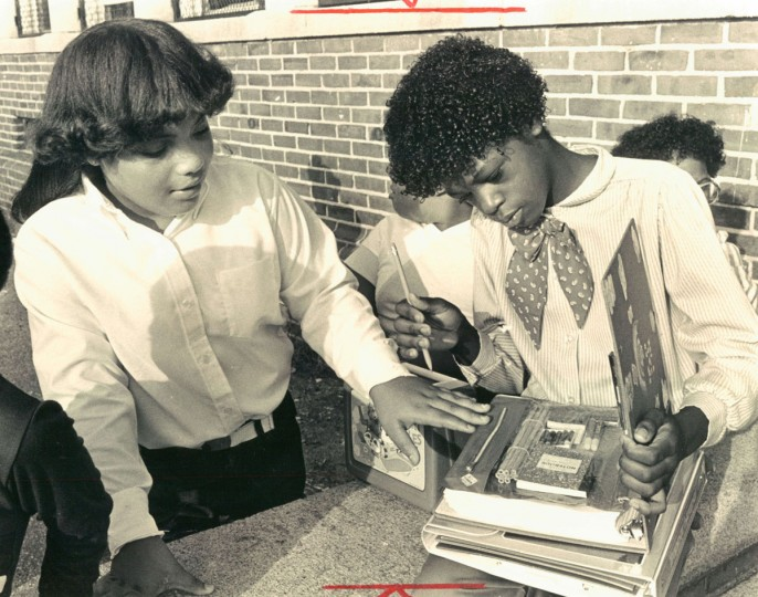 Fifth graders Shawn England and Keeli Stonefield check materials before first day of classes at Thomas Jefferson School. (Walter McCardell/Baltimore Sun, 1983)