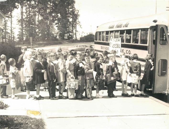 Children board a school bus, 1951. (Walter McCardell/Baltimore Sun)