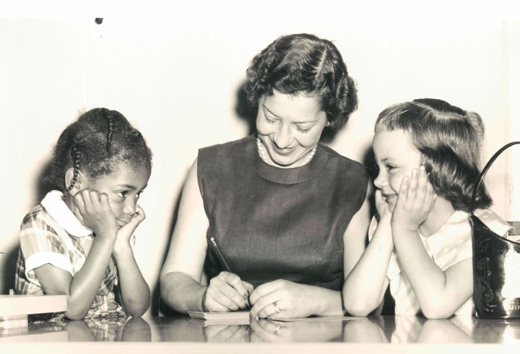 Mrs. Betty Sas registers Michelle Washington and Bonnie Candler at school. (Robinson/Baltimore Sun, 1959)