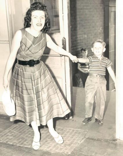Mrs. Phyllis Rarlovich pulling her son, Edward, into school for registration. (Ellis Malashuk/Baltimore Sun, 1959)