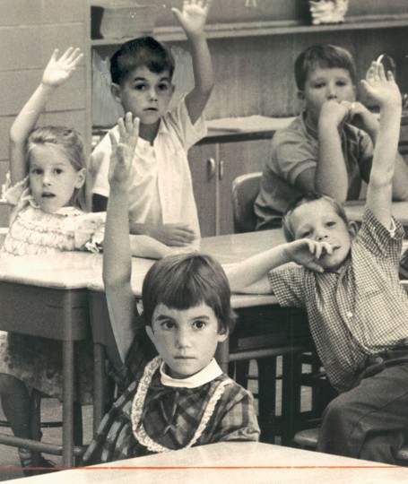 IN THE SWING - With her jitters subsiding, Laurie lofts an eager hand to answer a question. Other 6-year-olds are also finding that school may be more fun than expected. (George H. Cook/Baltimore Sun, 1969)