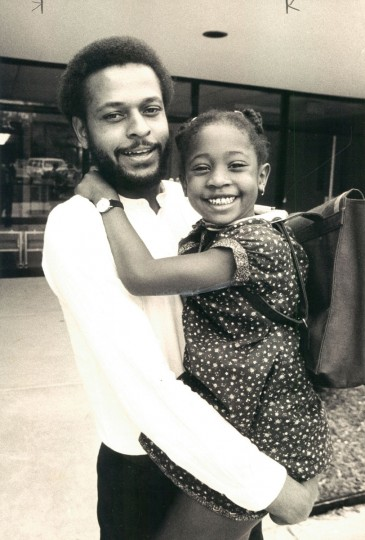 Khalil Abdul Rahman with his daughter, Maya, after the first day of school. (George H. Cook/Baltimore Sun, 1981)