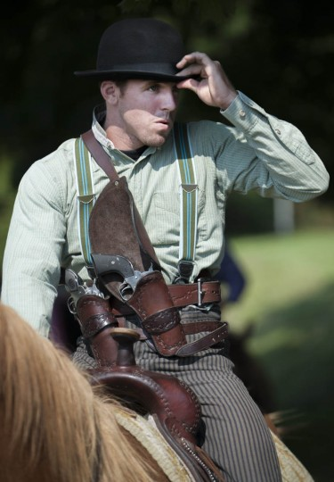 David Billotte, of Frenchville, PA, fixes the brim of his hat before a competition round. (Tom Brenner, Baltimore Sun)