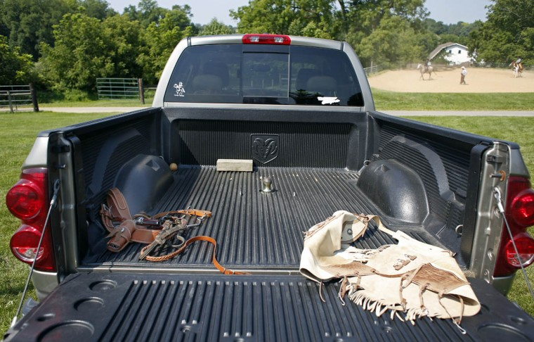 A pair of pistols lay in a pickup truck bed. (Tom Brenner, Baltimore Sun)