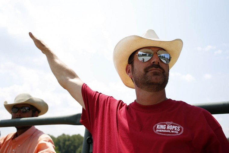 Rob Johnson, of Whitehall, PA, signals a cowboy before the start of a competition round. (Tom Brenner, Baltimore Sun)