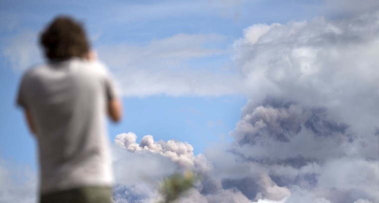 A man looks at the ashes spewed by the Cotopaxi volcano in Sangolqui, Ecuador on August 23, 2015. A dozen towns of central Ecuador, including Quito sector, suffered Saturday the ashes of the Cotopaxi volcano, which started erupting a week ago after 138 years, as crops and cattle were affected. (MARTIN BERNETTI/AFP/Getty Images)