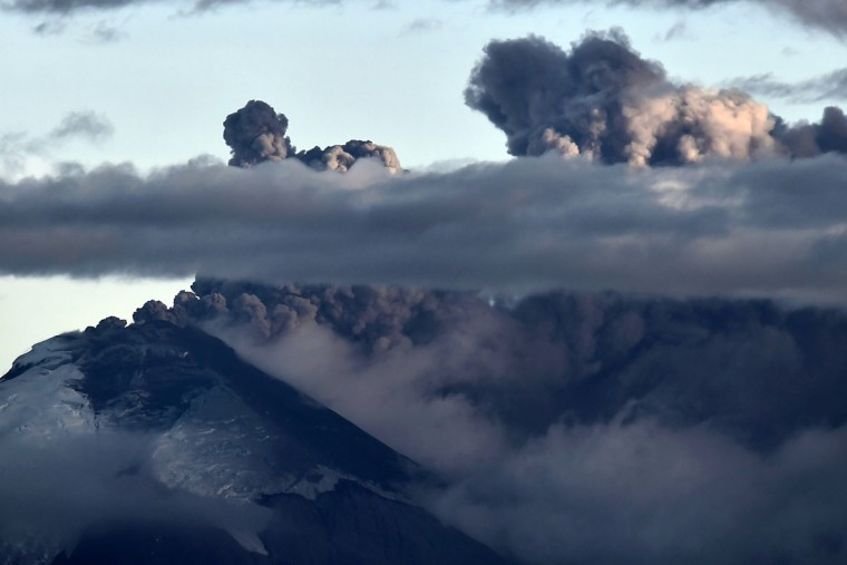 View of the Cotopaxi volcano spewing ashes from Quito, Ecuador on August 23, 2015. A dozen towns of central Ecuador, including Quito sector, suffered Saturday the ashes of the Cotopaxi volcano, which started erupting a week ago after 138 years, as crops and cattle were affected. (RODRIGO BUENDIA/AFP/Getty Images)