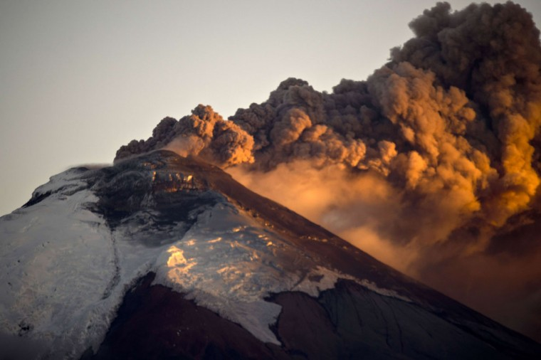 View of the Cotopaxi volcano spewing ashes from Sangolqui, Ecuador on August 23, 2015. A dozen towns of central Ecuador, including Quito sector, suffered Saturday the ashes of the Cotopaxi volcano, which started erupting a week ago after 138 years, as crops and cattle were affected. (MARTIN BERNETTI/AFP/Getty Images)